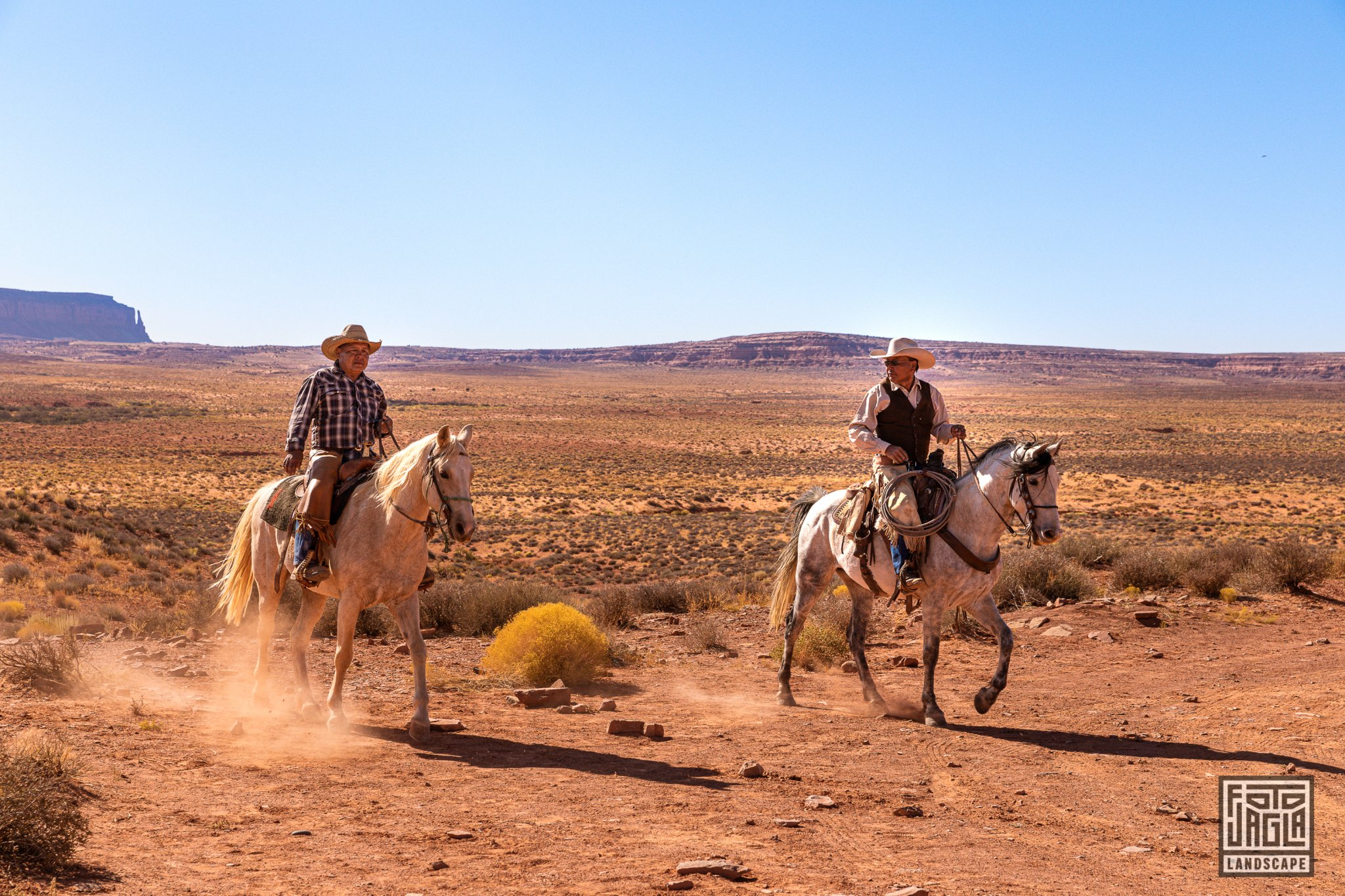 Horse riders at Monument Valley